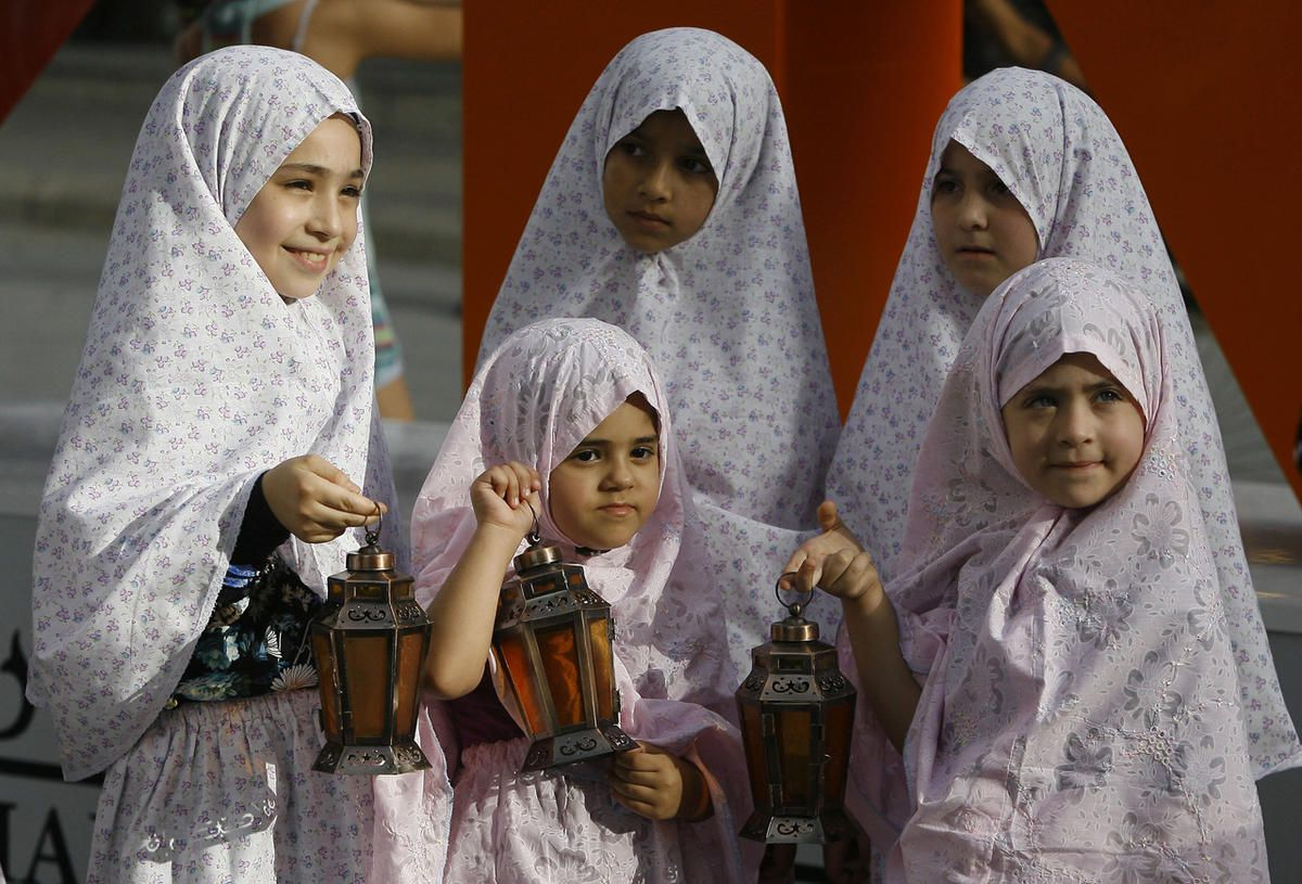 Description: C:\Users\user\Desktop\Lebanese girls hold traditional lanterns during street performances celebrating the upcoming holy month of Ramadan, in the southern port city of Sidon, Lebanon. Muslims throughout the world will begin to mark Ramadan this wee.jpg